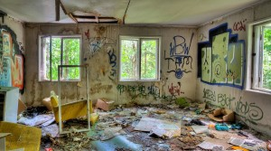 Adandoned Trashed House With Graffiti On Walls