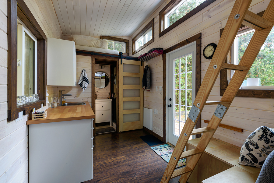Interior of a tiny home showing stairs to a loft sleeping area