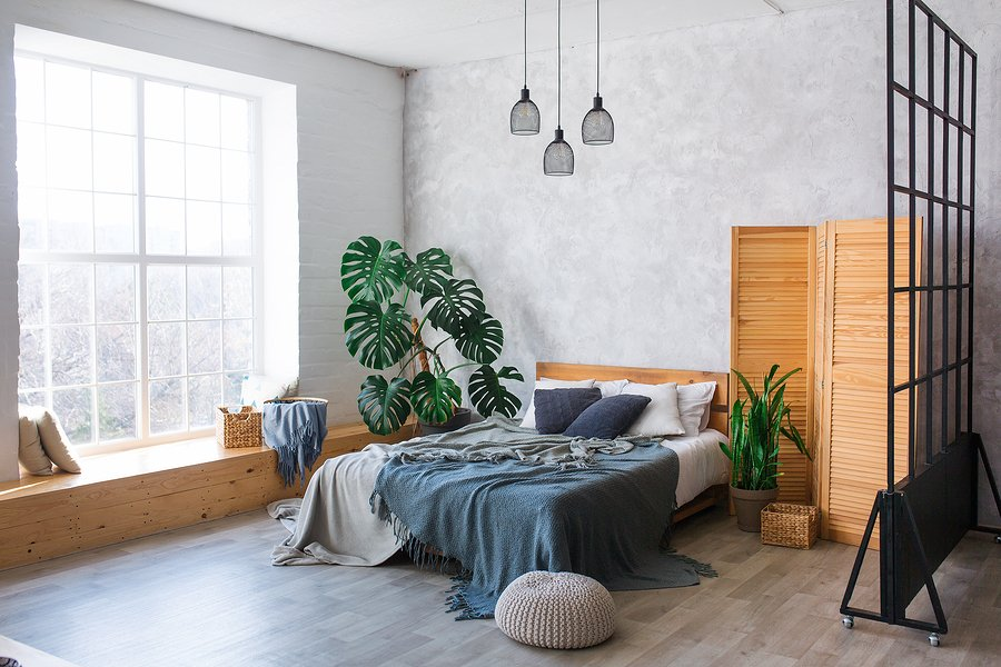 Cozy bedroom area in a studio apartment with a free layout